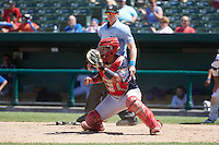 Peoria Chiefs catcher Jose Godoy (27) waits for a throw as umpire Andy Stukel looks on during the first game of a doubleheader against the South Bend Cubs on July 25, 2016 at Four Winds Field in South Bend, Indiana.  South Bend defeated Peoria 9-8.  (Mike Janes/Four Seam Images)