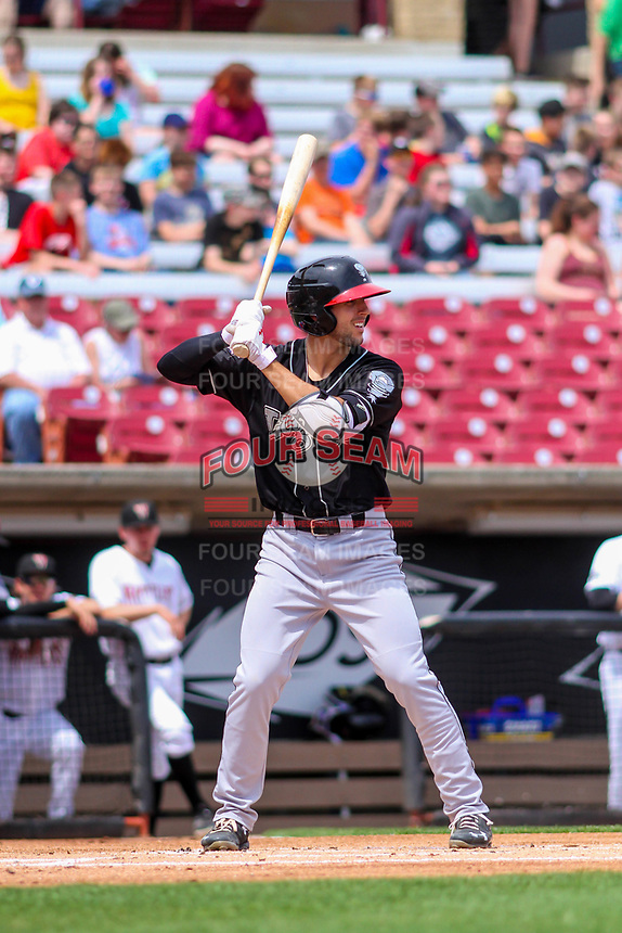 Lansing Lugnuts shortstop Kevin Smith (4) at bat during a Midwest League game against the Wisconsin Timber Rattlers on May 8, 2018 at Fox Cities Stadium in Appleton, Wisconsin. Lansing defeated Wisconsin 11-4. (Brad Krause/Four Seam Images)