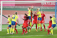 YOKOHAMA, JAPAN - AUGUST 6: Amanda Ilestedt #13 of Sweden and Stephanie Labbe #1 of Canada go for a ball during a game between Canada and Sweden at International Stadium Yokohama on August 6, 2021 in Yokohama, Japan.