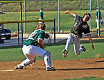 Out at home? Runner slides home as ball comes into waiting catcher.