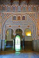 Arabesque Mudjar plasterwork and arches of the 12th century Salón de Embajadores (Ambassadors' Hall or Throne Room). Alcazar of Seville, Seville, Spain