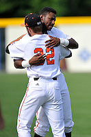 Center fielder Kyle Lewis (20) of the Mercer Bears hugs a teammate before a SoCon Tournament game against the Furman Paladins on Thursday, May 26, 2016, at Fluor Field at the West End in Greenville, South Carolina. Mercer won, 6-1. Lewis is considered a 2016 Top 5 draft pick. (Tom Priddy/Four Seam Images)