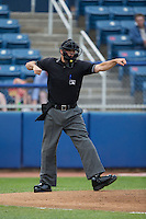 Home plate umpire Tucker Beneville calls a batter out on strikes during the Carolina League game between the Winston-Salem Dash and the Salem Red Sox at LewisGale Field at Salem Memorial Ballpark on May 14, 2015 in Salem, Virginia.  The Red Sox defeated the Dash 1-0.  (Brian Westerholt/Four Seam Images)