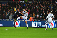 Lee Gregory of Millwall vies for possession with Cameron Carter-Vickers of Swansea City during the Sky Bet Championship match between Swansea City and Millwall at the Liberty Stadium in Swansea, Wales, UK. Saturday 09 February 2019