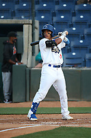 Jorbit Vivas (14) of the Rancho Cucamonga Quakes bats against the Modesto Nuts at LoanMart Field on May 12, 2021 in Rancho Cucamonga, California. (Larry Goren/Four Seam Images)