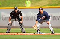 Gwinnett Braves first baseman Christian Marrero #33 holds a runner on as first base umpire Jon Byrne looks on during the International League game against the Charlotte Knights at Knights Stadium on June 3, 2012 in Fort Mill, South Carolina.  The Braves defeated the Knights 5-1.  (Brian Westerholt/Four Seam Images)