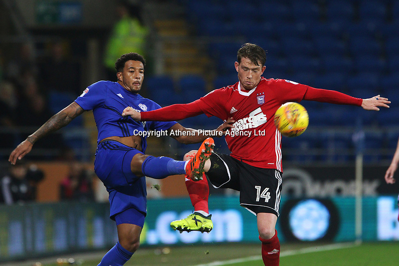 Nathaniel Mendez-Laing of Cardiff City is challenged by Joe Garner of Ipswich during the Sky Bet Championship match between Cardiff City and Ipswich Town at The Cardiff City Stadium, Cardiff, Wales, UK. Tuesday 31 October 2017