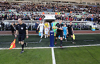 SWANSEA, WALES - FEBRUARY 07: Referee Phil Dowd grabs the ball before the Premier League match between Swansea City and Sunderland AFC at Liberty Stadium on February 7, 2015 in Swansea, Wales.