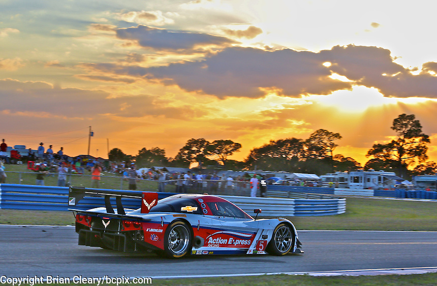 The #5 Chevrolet Corvette DP of Joao Barbosa, Christian Fittipaldi and Sebastien Bourdais races at sunset during the 12 Hours of Sebring, Sebring International Raceway, Sebring, FL, March 2014.  (Photo by Brian Cleary/www.bcpix.com)