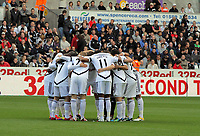 Pictured: Swansea players huddle before kick off.  Saturday 17 September 2011<br /> Re: Premiership football Swansea City FC v West Bromwich Albion at the Liberty Stadium, south Wales.