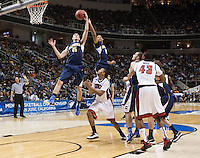 March 21st, 2013: California's David Kravish and Allen Crabbe rebounds the ball away from UNLV during a game at HP Pavilion, San Jose, California. California defeated UNLV 64 - 61