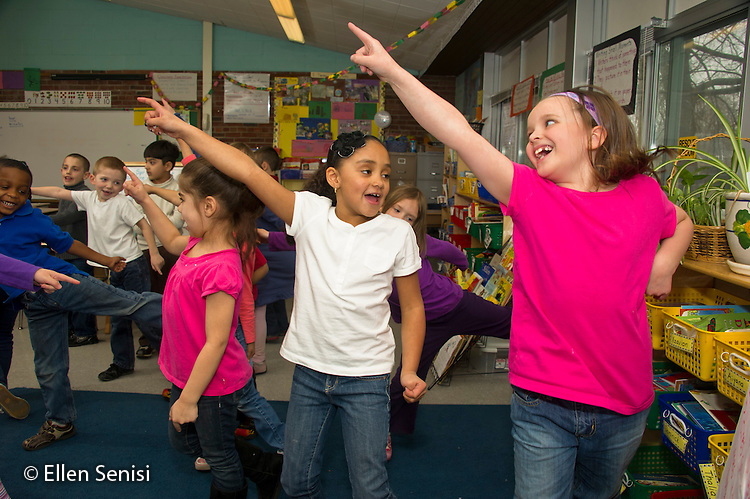 MR / Schenectady, New York. Paige Elementary School (urban public elementary school). First grade classroom. Students move together with music in classroom creative movement activity. MR: AL-g1g. ID: AL-g1g. © Ellen B. Senisi.