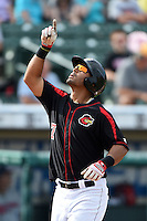 Rochester Red Wings outfielder Wilkin Ramirez (7) points the sky after hitting a home run during the first game of a doubleheader against the Buffalo Bisons on July 6, 2014 at Frontier Field in Rochester, New  York.  Rochester defeated Buffalo 6-1.  (Mike Janes/Four Seam Images)