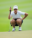 CHON BURI, THAILAND - FEBRUARY 17:  Paige Mackenzie of USA lines up a putt on the 17th green during day two of the LPGA Thailand at Siam Country Club on February 17, 2012 in Chon Buri, Thailand.  Photo by Victor Fraile / The Power of Sport Images