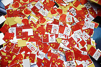 Stickers bearing Chinese flags, the Olympic rings, and the logo of the 2008 Beijing Olympic Games, lay in a pile for sale near the route of the Nanjing, China, leg of the 2008 Olympic Torch Relay.  .