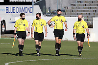 RICHMOND, VA - SEPTEMBER 30: Referee Matt Franz walks onto the field with his assistant referees Nicholas Seymour and Max Smith and fourth official JC Griggs before a game between North Carolina FC and New York Red Bulls II at City Stadium on September 30, 2020 in Richmond, Virginia.
