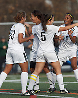 College of St Rose forward Carmelina Puopolo (5) celebrates her second goal with teammates.. In 2012 NCAA Division II Women's Soccer Championship Tournament First Round, College of St Rose (white) defeated Wilmington University (black), 3-0, on Ronald J. Abdow Field at American International College on November 9, 2012.