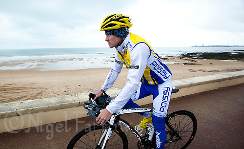 28 APR 2012 - LES SABLES D'OLONNE, FRA - A Poissy Triathlon competitor cycles to the start of the prologue round of the French Grand Prix Series triathlon in Les Sables d'Olonne, France .(PHOTO (C) 2012 NIGEL FARROW)