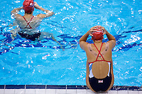 26 JUL 2012 - LONDON, GBR - Synchronised Swimmer Asha Randall (GBR) (right) of Great Britain prepares for the start of practice at the Aquatics Centre in the Olympic Park, Stratford, London, Great Britain ahead of the start of the London 2012 Olympic Games .(PHOTO (C) 2012 NIGEL FARROW)