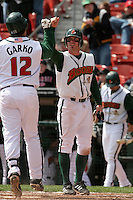 Buffalo Bisons Joe Inglett greets Ryan Garko #12 at home plate after a home run during an International League game at Dunn Tire Park on April 17, 2006 in Buffalo, New York.  (Mike Janes/Four Seam Images)