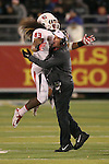 Fresno State's Karl Mickelsen (43) celebrates with Head Coach Tim DeRuyter after a big defensive play against Nevada during the first half of an NCAA college football game in Reno, Nev., on Saturday, Nov. 22, 2014. (AP Photo/Cathleen Allison)