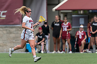 NEWTON, MA - MAY 14: Amy Moreau #3 of University of Massachusetts brings the ball forward during NCAA Division I Women's Lacrosse Tournament first round game between University of Massachusetts and Temple University at Newton Campus Lacrosse Field on May 14, 2021 in Newton, Massachusetts.