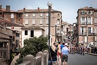 Peloton riding through Gaillac. <br /> <br /> Stage 11: Albi to Toulouse (167km)<br /> 106th Tour de France 2019 (2.UWT)<br /> <br /> ©kramon