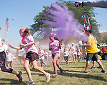 """August 26, 2017- Tuscola, IL- Runners participate in the Tuscola CUSD 301's """"Can Do for Classrooms Color Run"""" at East Prairie Middle School. The fundraiser helped raise money for supplemental and enrichment materials for classrooms in all three Tuscola buildings [Photo: Douglas Cottle]"""