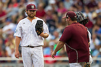 Mississippi State pitcher Trevor Fitts (31) on the mound before being removed by Pitching Coach Butch Thompson during Game 1 of the 2013 Men's College World Series Finals against the UCLA Bruins on June 24, 2013 at TD Ameritrade Park in Omaha, Nebraska. The Bruins defeated the Bulldogs 3-1, taking a 1-0 lead in the best of 3 series. (Andrew Woolley/Four Seam Images)