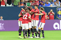 Houston, TX - Thursday July 20, 2017: Marcus Rashford celebrates his goal with his teammates during a match between Manchester United and Manchester City in the 2017 International Champions Cup at NRG Stadium.