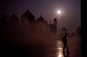Tourist at dawn in mist, Taj Mahal, Agra, Uttar Pradesh, India