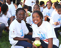 """Kids eat apples during a  D.C United clinic in support of first lady Michelle Obama's """"Let's Move"""" initiative on the White House lawn, in Washington D.C. on October 7 2010."""