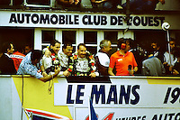 12.06.1988. Le Mans 24 Hours. The winning Tom Walkinshaw Racing Jaguar team of Jan Lammers, Johnny Dumfries and Andy Wallace celebrate on the podium.Dumfries, real name John Colum Crichton-Stuart, 7th Marquis of Bute, passed away on 22nd March 2021 after a brief illness