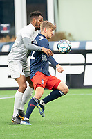 FOXBOROUGH, MA - APRIL 17: Justin Rennicks #12 of New England Revolution II controls a high ball under pressure from Ivan Magalhaes #4 of Richmond Kickers during a game between Richmond Kickers and Revolution II at Gillette Stadium on April 17, 2021 in Foxborough, Massachusetts.