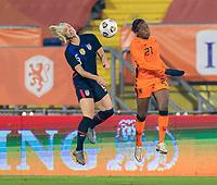 BREDA, NETHERLANDS - NOVEMBER 27: Julie Ertz #8 of the USWNT goes up for a header with Lineth Beerensteyn #21 of the Netherlands during a game between Netherlands and USWNT at Rat Verlegh Stadion on November 27, 2020 in Breda, Netherlands.