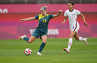 KASHIMA, JAPAN - JULY 27: Ellie Carpenter #12 of Australia moves with the ball before a game between Australia and USWNT at Ibaraki Kashima Stadium on July 27, 2021 in Kashima, Japan.