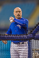 4 April 2015: Toronto-born, Toronto Blue Jays bullpen catcher Alex Andreopoulos tosses batting practice prior to an exhibition game against the Cincinnati Reds at Olympic Stadium in Montreal, Quebec, Canada. The Blue Jays defeated the Reds 9-1 in the second of two MLB weekend exhibition games. Mandatory Credit: Ed Wolfstein Photo *** RAW (NEF) Image File Available ***