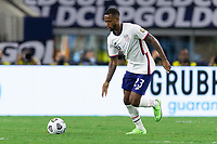DALLAS, TX - JULY 25: Kellyn Acosta #23 of the United States moves with the ball during a game between Jamaica and USMNT at AT&T Stadium on July 25, 2021 in Dallas, Texas.