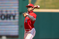Shortstop Jordan Lawlar (11) throws to first base during the Baseball Factory All-Star Classic at Dr. Pepper Ballpark on October 4, 2020 in Frisco, Texas.  Jordan Lawlar (11), a resident of Irving, Texas, attends Jesuit College Preparatory School of Dallas.  (Ken Murphy/Four Seam Images)