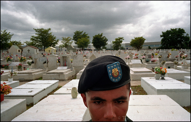A Puerto Rican U.S. Army soldier stands at attention in a local cemetery in Caguas in the United States territory of Puerto Rico where a fellow soldier who killed in Iraq is buried on July 24, 2003. Unlike American soldiers from the 50 states, Puerto Ricans are not allowed to vote for U.S. President.