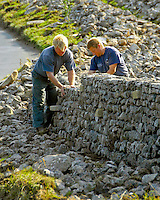 Full-time stone wallers and sheep shearers Phillip Hargreaves and Roger Charnley tackle  a 160 metre limestone stretch between Kilnsey and Kettlewell, North Yorkshire.