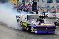 Oct. 31, 2008; Las Vegas, NV, USA: NHRA pro modified driver Joshua Hernandez does a burnout during qualifying for the Las Vegas Nationals at The Strip in Las Vegas. Mandatory Credit: Mark J. Rebilas-