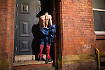 © Joel Goodman - 07973 332324 . 27/12/2015 . Wigan , UK . A man dressed as Superman urinates in a doorway . Revellers in Wigan enjoy Boxing Day drinks and clubbing in Wigan Wallgate . In recent years a tradition has been established in which put on fancy dress for a Boxing Day night out . Photo credit : Joel Goodman