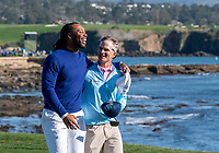 9th February 2020, Pebble Beach, Carmel, California, USA; Kevin Streelman and Larry Fitzgerald celebrate the Pro-Am title in the championship round of the AT&T Pro-Am on Sunday
