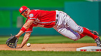 14 April 2013: Washington Nationals third baseman Ryan Zimmerman dives to get Atlanta Braves infielder Chris Johnson out in the 7th inning at Nationals Park in Washington, DC. The Braves shut out the Nationals 9-0 to sweep their 3-game series. Mandatory Credit: Ed Wolfstein Photo *** RAW (NEF) Image File Available ***