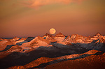 Pictured: The supermoon rises over the Minarets in Sierra Nevada, California, USA. <br /> <br /> Amazing aerial photos show off the majesty of America's landscape, its architecture, its industry and its wildlife.   From the startling blue potash pools of Utah to hundreds of aircraft sitting unused due to the pandemic, the images display a little seen side of the USA.<br /> <br /> Other images include a passenger plane plane as it touches down in California taken 4,500ft above it, fog over the Golden Gate Bridge and a solar farm in Nevada.   Professor of Music Jassen Todorov, from San Francisco, captured the striking pictures of the American West while flying in a light aircraft.   SEE OUR COPY FOR DETAILS<br /> <br /> Please byline: Jassen Todorov/Solent News<br /> <br /> © Jassen Todorov/Solent News & Photo Agency<br /> UK +44 (0) 2380 458800