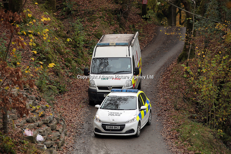 Pictured: Police a fire service vehicle at the entrance to the track leading to the house that burned in Llangammarch Wells, Powys, Wales, UK. Tuesday 31 October 2017<br />Re: Investigations continue into a house fire in which a father and several of his children have died.<br />Three children aged 13, 12 and 10 escaped the farmhouse in Llangammarch Wells, Powys, in the early hours of Monday and raised the alarm.<br />Police said they could not identify the deceased or confirm numbers.<br />One of those missing has been named locally as David Cuthbertson.