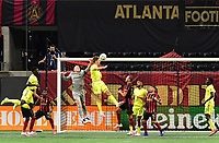 ATLANTA, GA - AUGUST 22: Brad Guzan #1 and Walker Zimmerman #25 contest a crossed pass during a game between Nashville SC and Atlanta United FC at Mercedes-Benz Stadium on August 22, 2020 in Atlanta, Georgia.