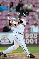 Salem-Keizer first baseman Ben Thomas #13 bats against the Eugene Emeralds at Volcanoes Stadium on August 9, 2011 in Salem-Keizer,Oregon. Eugene defeated Salem-Keizer 13-7.(Larry Goren/Four Seam Images)