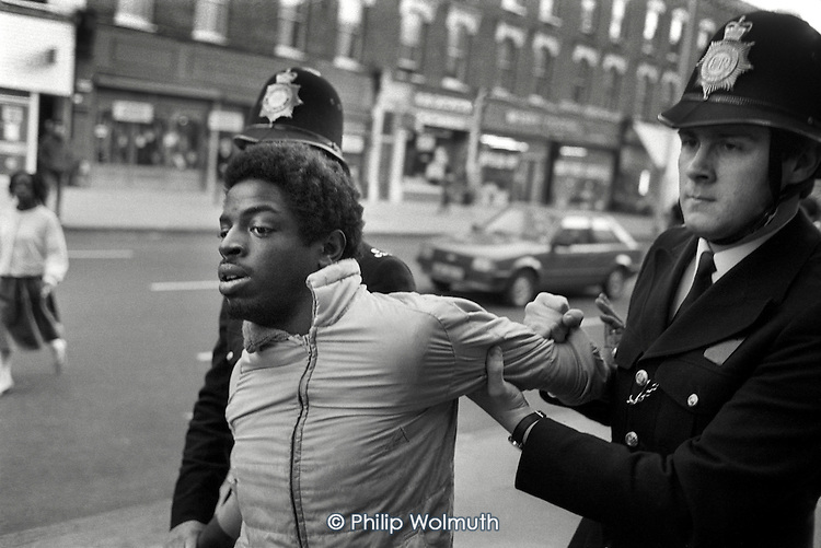 Arrest at a demonstration to demand an enquiry into the death from gunshot wounds of Colin Roach, a young black man found dead on the steps of Stoke Newington police station.